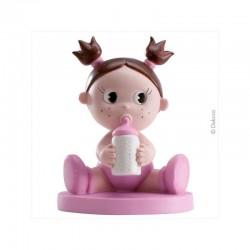 Bebe menina com biberon